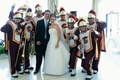 Bride and groom with University of Southern California marching band