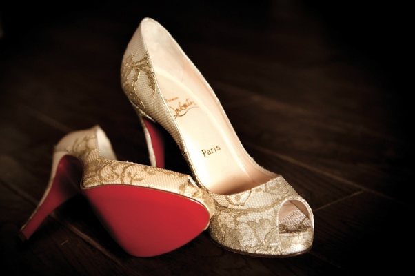 Bride's Louboutin peep-toe heels with golden lace