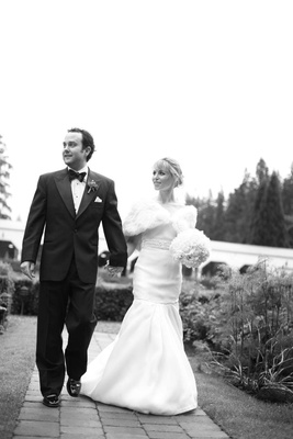 black and white bride and groom walking to wedding