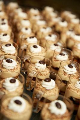 Tiramisu looking desserts in small clear mugs at wedding reception