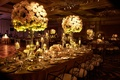 Wedding reception in Chicago tall high centerpieces with candlelight romantic sexy lighting