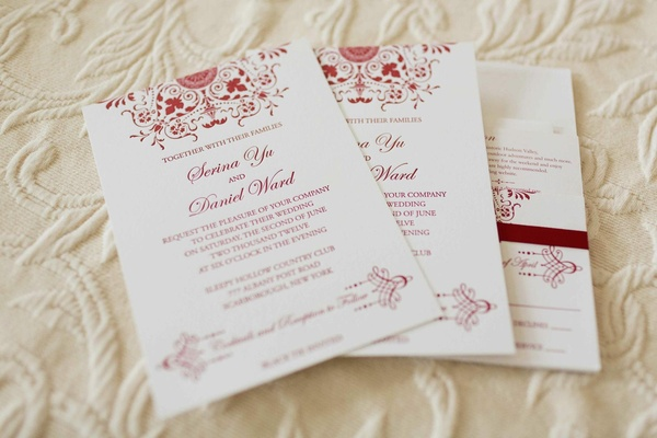 Wedding invitation suite with red font