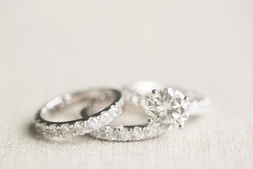 Wedding ring eternity band pave diamonds around band round solitaire engagement ring four prongs