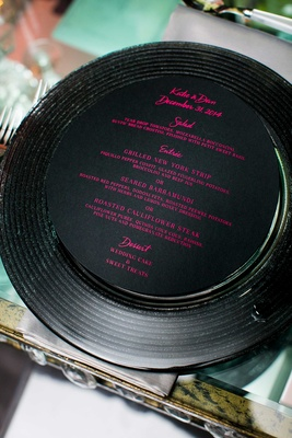 new year's eve wedding, black menu with pink writing