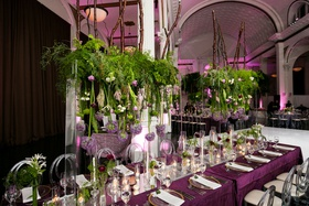 Vibiana wedding reception purple linens clear acrylic chairs greenery orbs candles