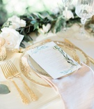 wedding reception table setting white menu card herb design gold forks flatware wood table