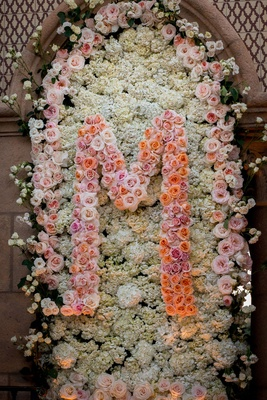 Wedding ceremony flower wall panel with rose initial and hydrangea flowers
