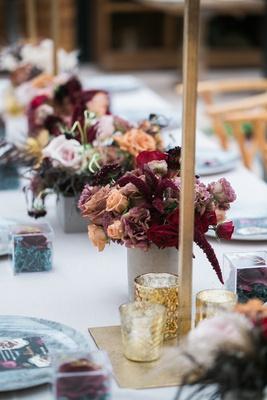 small vases with burgundy, peach roses, astilbe, mercury votives