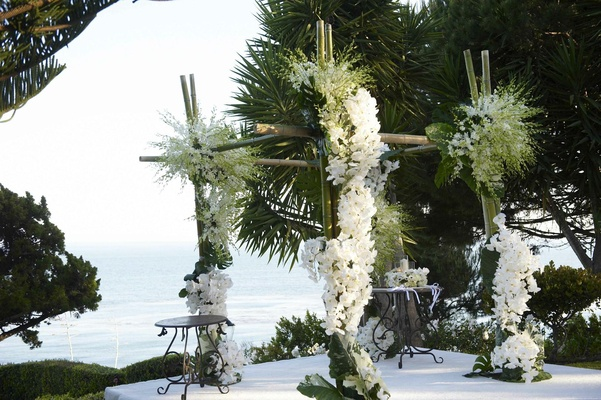 Bamboo wedding ceremony altar with white flowers