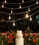 Intimate-sized wedding cake on outdoor terrace
