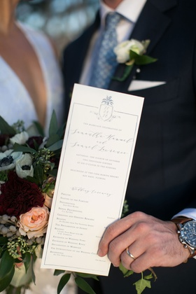 Wedding program with modern calligraphy ceremony proceedings and custom crest pineapple motif