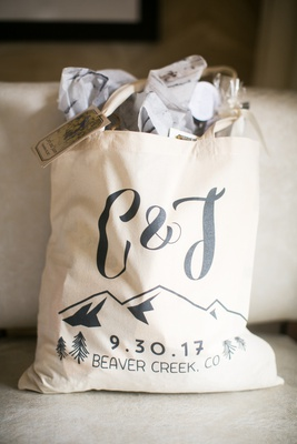 welcome bags for colorado destination wedding with initials, mountains, wedding date