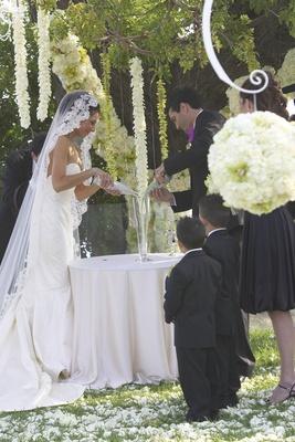 Ring bearers watching bride and groom
