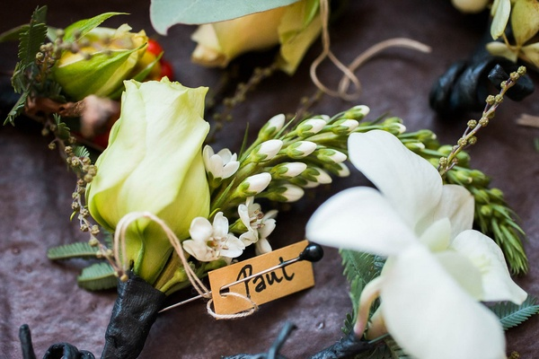Wedding guest rustic boutonnieres with an ivory rose, orchid and greenery