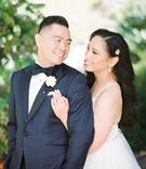bride in hayley paige wedding dress long hair headpiece groom in tuxedo bow tie pocket square flower