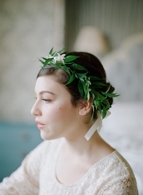 Green leaf and white flower crown on bridesmaid