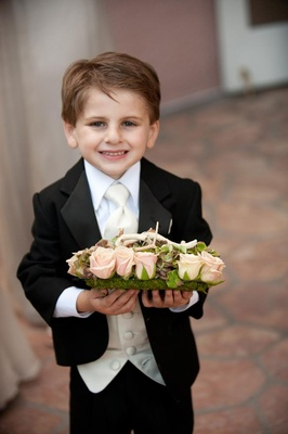 Cute ring bearer tuxedo and bed of succulents