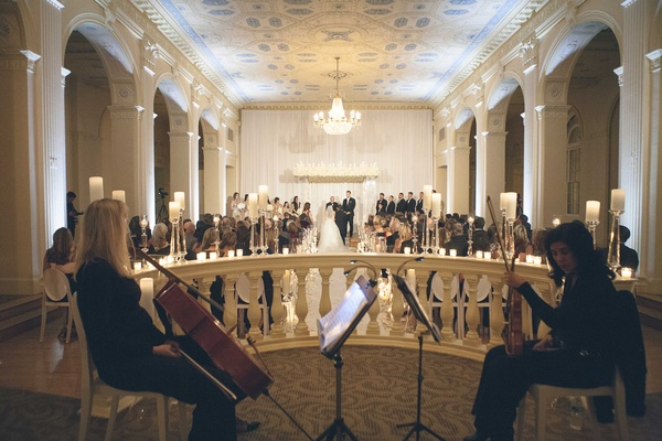 Cello player and violin player on stage at biltmore ballrooms wedding in Atlanta on New Year's Eve