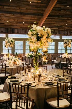 rod iron candelabra centerpieces hydrangea roses lisianthus veronica dahlias Queen Anne's lace