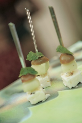Skewer in two kinds of cheese with olive and apple and mint