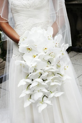 Bride holding hydrangea and orchid flowers