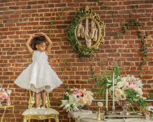 pantora mini flower girl dress with flare skirt and ruffled floral details, ballet pose