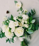 weedding bouquet greenery leaves white roses dahlia flowers wrapped with ribbon exposed stems
