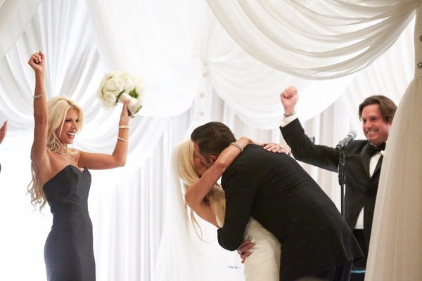 maid of honor and best man celebrate during bride and groom's first kiss