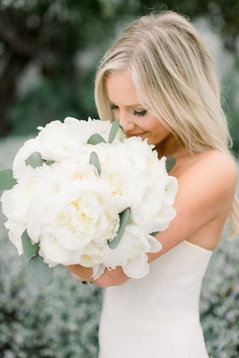 taylour rutledge bride smelling white bouquet peony garden rose ranunculus flowers