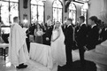 black and white photo of bride and groom at ceremony in palm beach catholic wedding