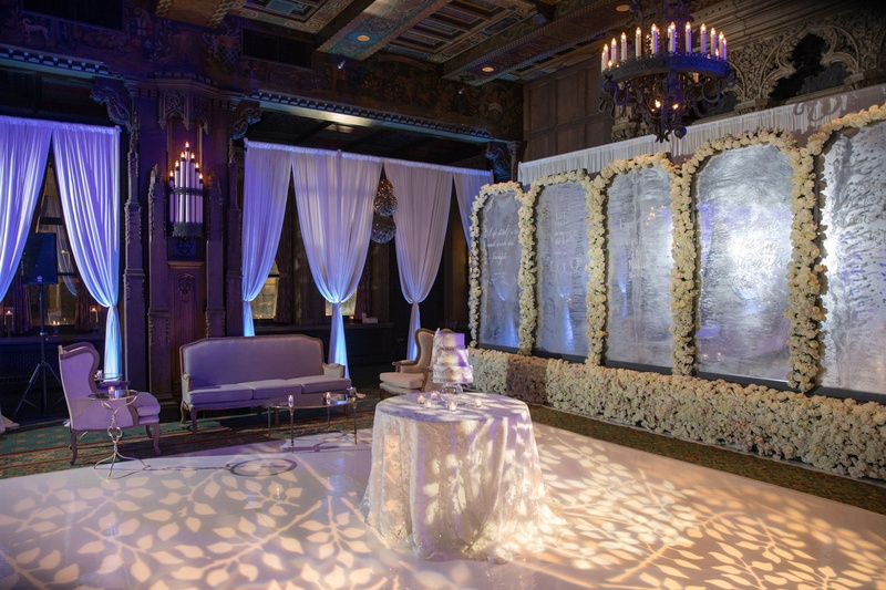 Wedding reception styled shoot lounge area cake table foliage motif on dance floor flower wall