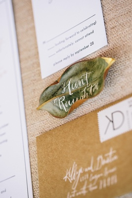 Green tree leaf with white calligraphy lettering