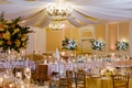 wedding reception in ballroom at the ballantyne resort in charlotte north carolina chandelier drapes