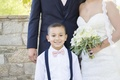 brides son smiles couple pink bowtie happy catholic ceremony california wedding suspenders navy