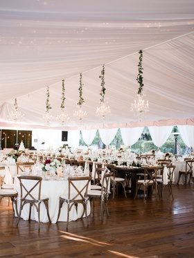 Wedding reception tent wood floor chandeliers x back wood chairs rustic refined elegant lowcountry
