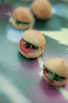 Mini sandwich appetizer at wedding with tomato and mushroom