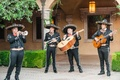 Wedding reception mariachi band four person band guitars sombreros and trumpet at outdoor wedding