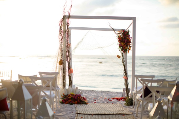 white arbor beach mexico colorful flowers chuppah altar punta mita wedding styled shoot sand ocean