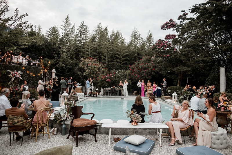 Ashley Castaños daughters of simone wedding designer guests at reception pool lake como italy