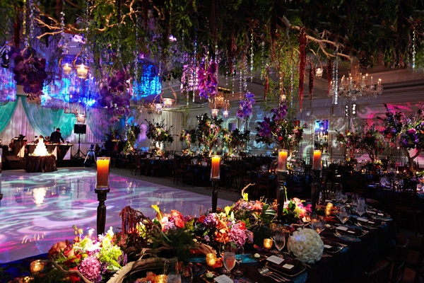 crystal strands and greenery suspended from ceiling in enchanted forest themed wedding