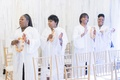 Dallas Texas wedding ceremony with surprise gospel choir music before bride's entrance processional