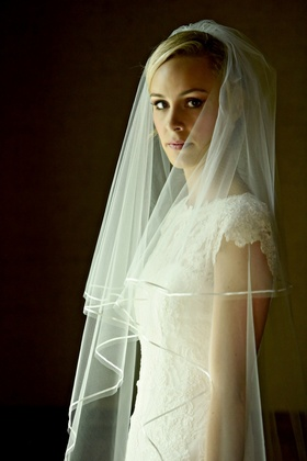 a bride waits for the ceremony in her veil