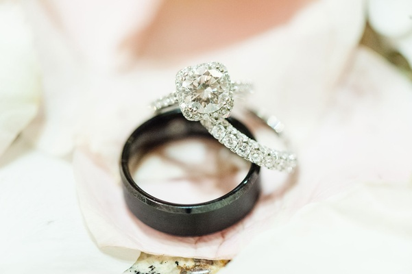 Bride round diamond square halo engagement ring with eternity band and men's black Manly Bands ring