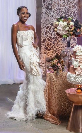 bride posing intricate feathered dress wedding styled shoot purple metallics new york strapless