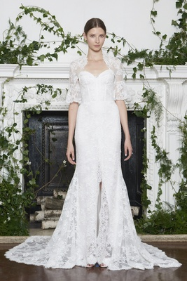 Monique Lhuillier Fall 2018 Lace gown, corset bodice, slit in skirt, lace jacket with half sleeves