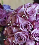 Wedding bouquet with purple roses and dotted crystals