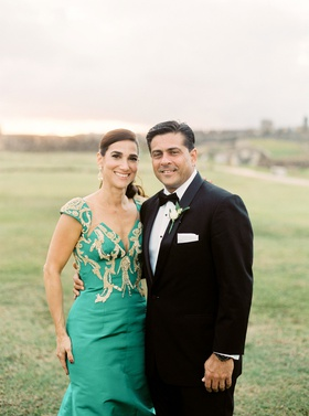 wedding portrait san cristobal fort puerto rico father of groom and mother of groom green gold gown
