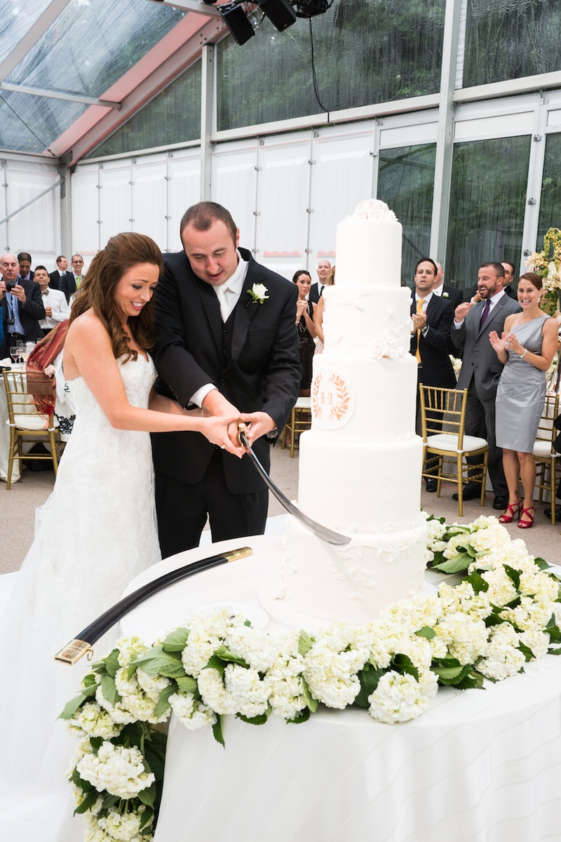 cutting wedding cake with sword couples photos cake cutting with sword inside weddings 13304