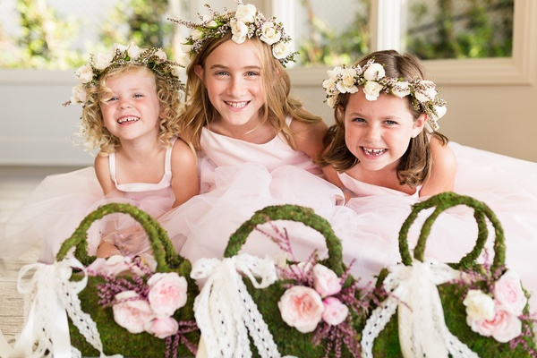 flower girls in pink dresses, flower crowns, moss purse baskets