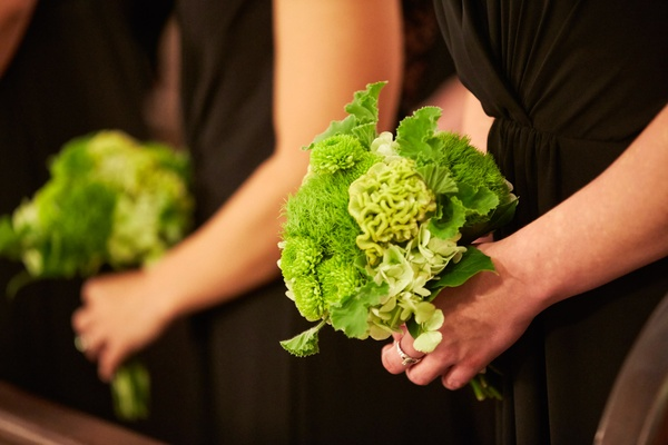 Green bridesmaid bouquets filled with textured blooms and foliage including cockscomb, mums, and gre